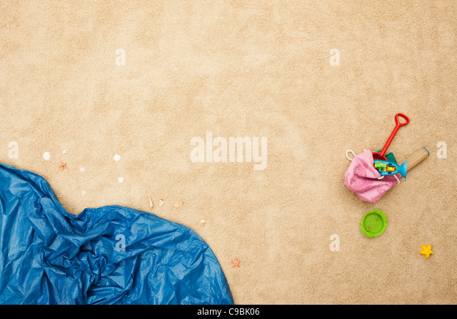 Germany, Beach toys and waves on beach - Stock Image