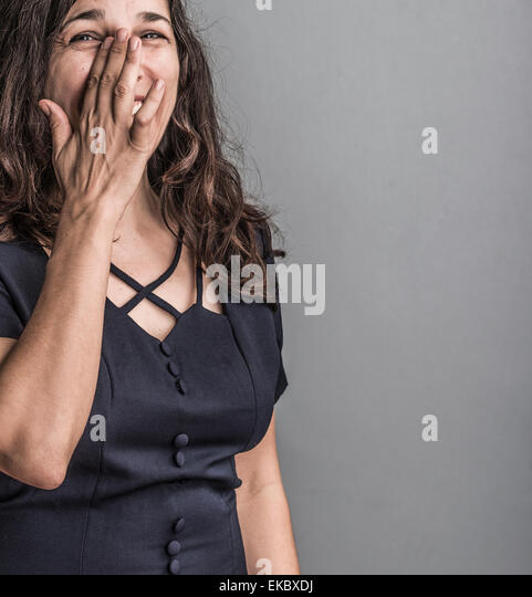 Portrait of mature woman, crying with laughter - Stock Image