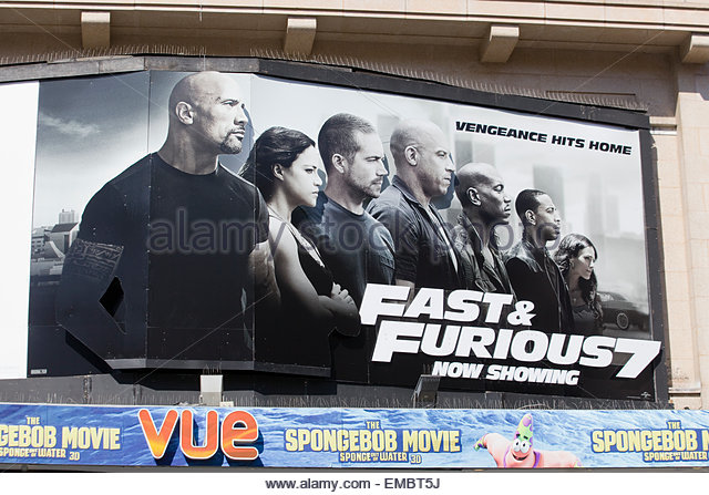 Poster advertising The fast and the Furious 7 starring the Late Paul Walker in his final film - Stock Image