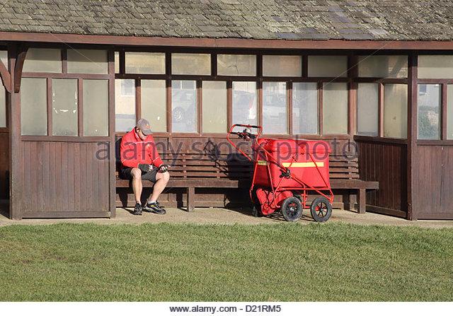 postman taking a break in hampshire - Stock Image