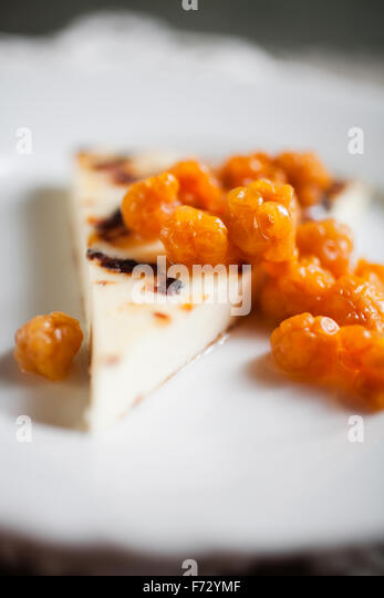 Finnish cheese with fresh cloudberries - Stock Image