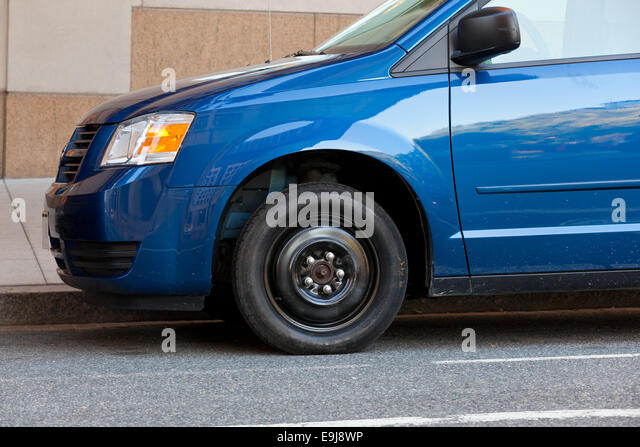 Spare tire on minivan - USA - Stock Image
