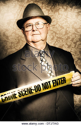 Artistically aged portrait of an astute fifties crime investigator with a stoical expression watching carefully - Stock-Bilder