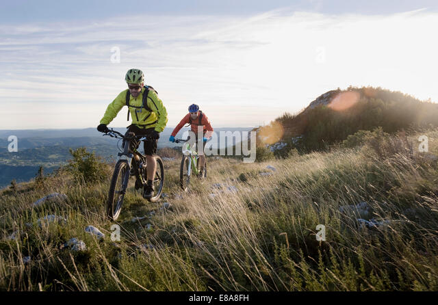 two mountain bikers on the way downhill, Vipava valley, Istria, Slovenia - Stock-Bilder
