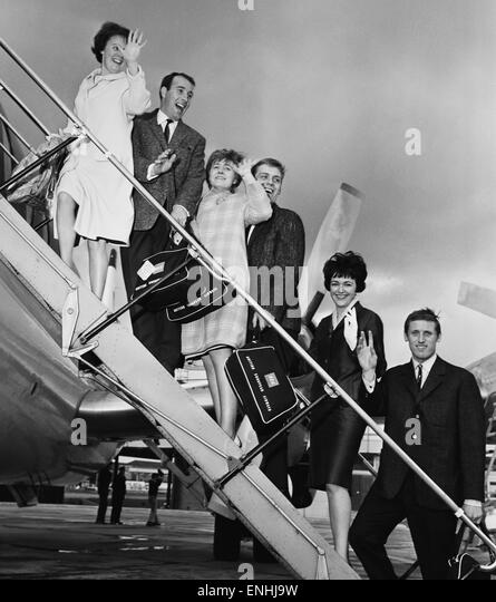 Everton players and wives at Ringway airport, Manchester bound for Torremolinos, Spain on a two week holiday after - Stock Image