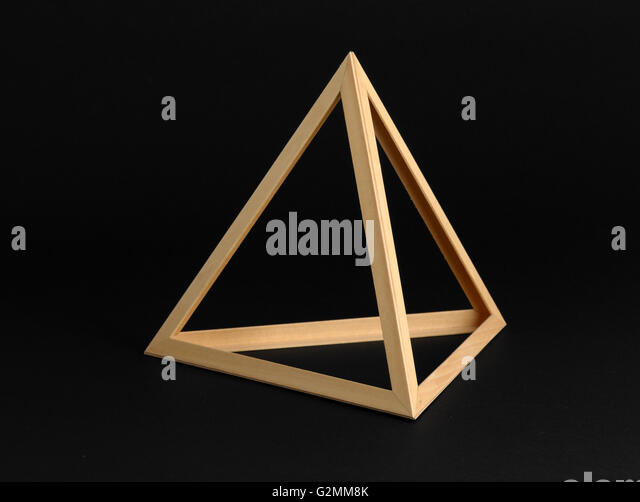 Three dimensional geometric wooden triangular frame isolated on a black background - Stock Image