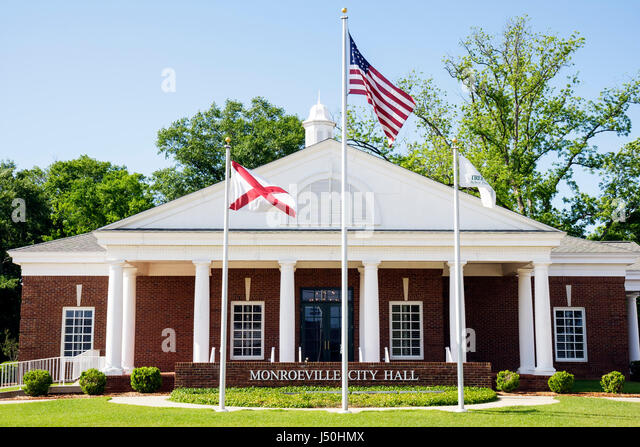 Monroeville Alabama City Hall small town flag public building Greek revival architecture pediment local government - Stock Image