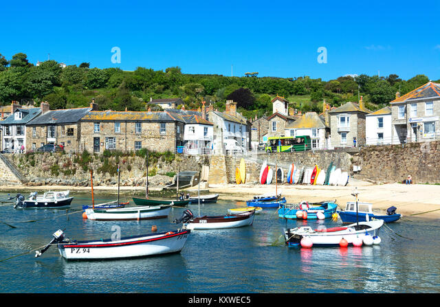 fishing boats in the harbour at mousehole, cornwall, england, britain, uk. - Stock Image