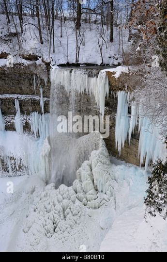 Icicles and Stalagmites in Spencer Gorge at Tews Falls Dundas Canada in winter after a cold snap - Stock Image