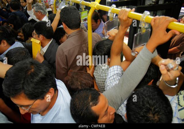Peru Lima Avenida Emancipacion Metropolitano Bus Line public transport bus standing Hispanic man exit passenger - Stock Image