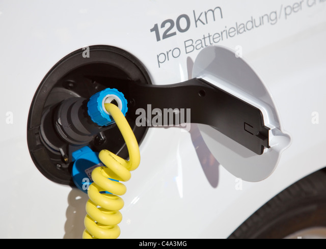 Plug and Charging Cable on an Electric Car in Germany - Stock Image