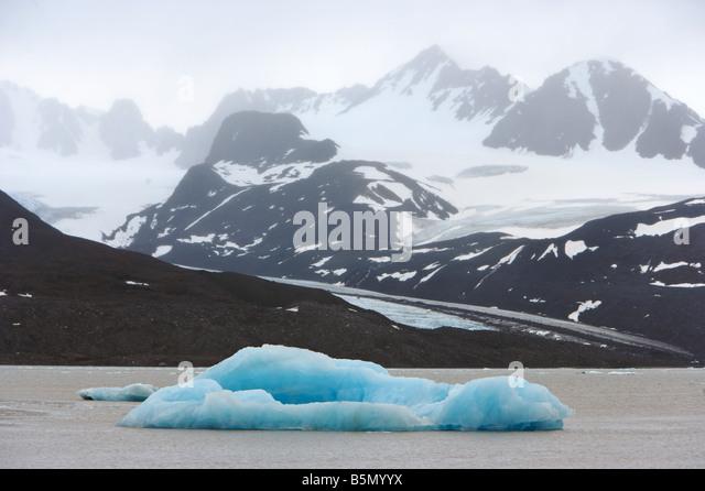 Drifting iceberg in fjord - Stock Image