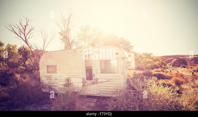 Vintage stylized picture of old trailers, USA countryside. - Stock Image