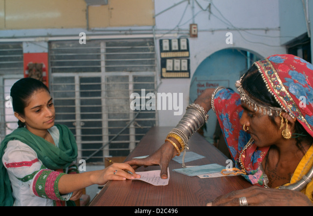 Rural Woman Putting A Thumb Impression In A Bank To Open Her Bank Account At Bank, Ahmedabad.India - Stock Image