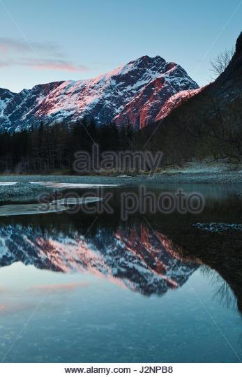 Romsdalen valley, Møre og Romsdal, Norway, April 29th, 2017. Last evening light on the mountain Blånebba. - Stock-Bilder