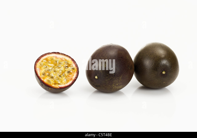 Ripe passion fruits cut into two halves - Stock Image