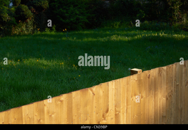 Fence and garden - Stock Image