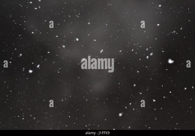 Snow flakes captured at night - Stock Image
