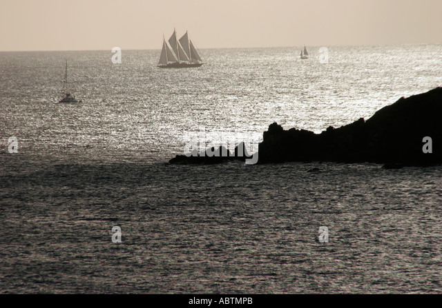 Sint Maarten Caribbean Sea rocks masted sailing ship - Stock Image