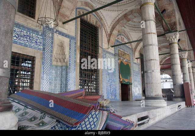 Prayer Mats at the entrance of the Rustem Pasha Mosque, Istanbul, Turkey - Stock Image