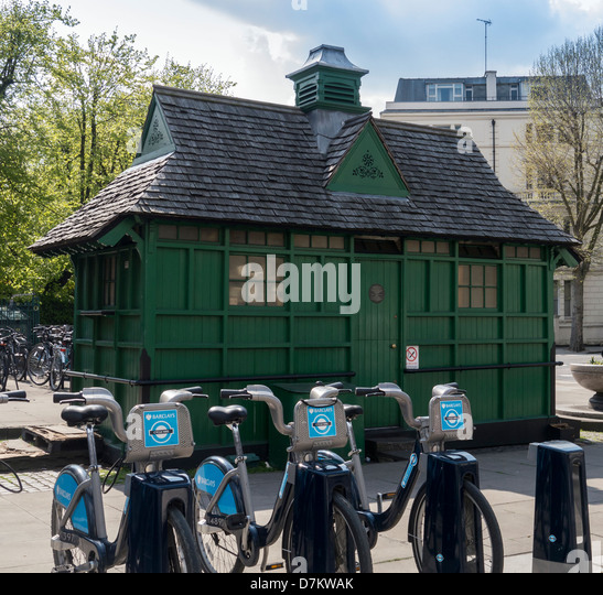 Hire Bikes in front Green Cabmen's Shelter close by Warwick Avenue Station, London - Stock Image
