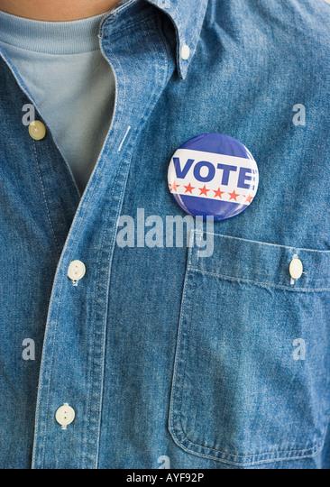 Vote pin on man's shirt - Stock Image