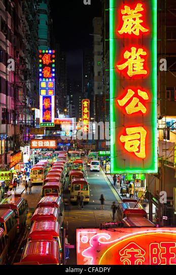 Street scene, Mini bus station and Neon lights of Mong Kok, Kowloon, Hong Kong, China - Stock Image