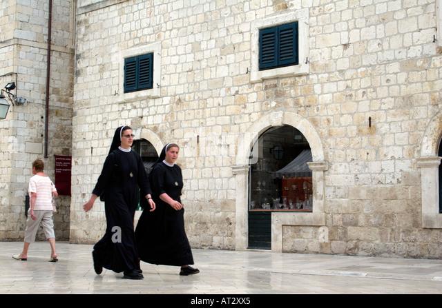 Nuns walking in the Placa Luza, Dubrovnik, Croatia, - Stock Image