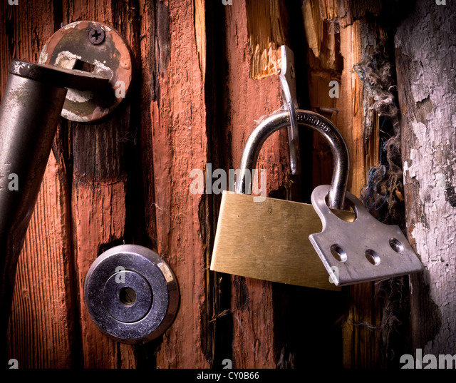 Broken padlock on a door - Stock Image