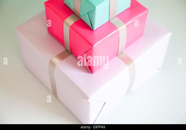 Stack of three wrapped gifts - Stock Image