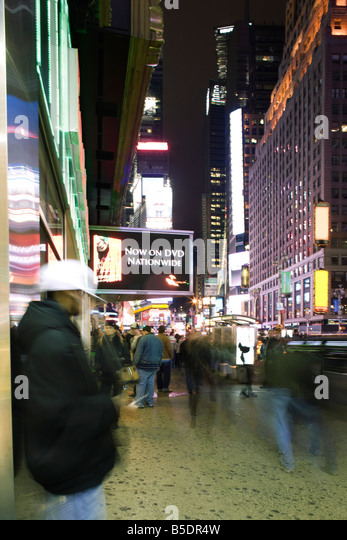 Sidewalk scene on Broadway in New York City looking north at Times Square - Stock Image