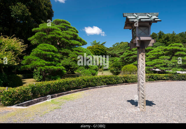Lantern in the garden of complex Ise Jingu, Japan - Stock Image