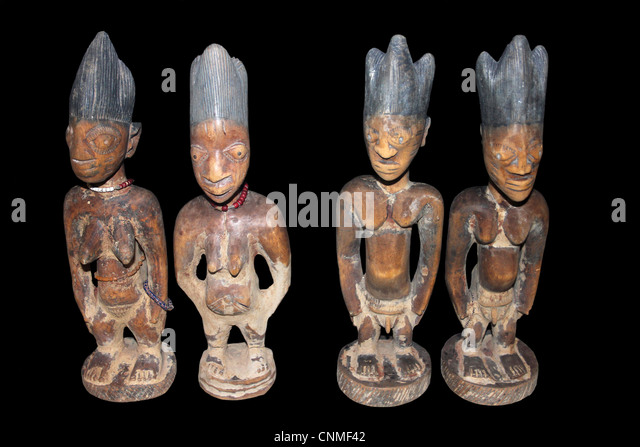 Nigerian Ibeji Figures - Carved Wooden Figures Made To House The Soul Of A Dead Twin - Stock Image