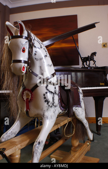 Baby grand piano stock photos baby grand piano stock for Hand crafted rocking horse