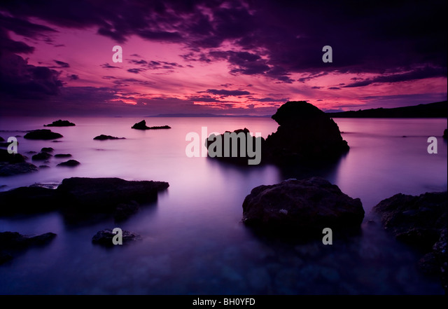 Dusk view from Kalamitsi beach across the Messinian bay of the southern Peloponnese of Greece - Stock-Bilder