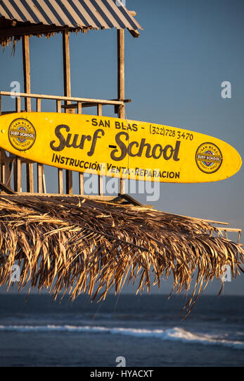 Surf school sign on the beach of San Blas, Nayarit, Mexico. - Stock Image