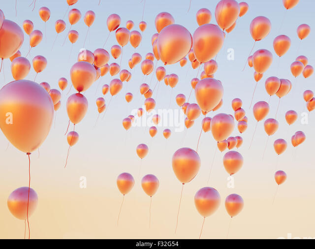 Colorful small balloons flying up to the sky - Stock Image