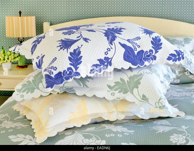 pile of 3 pillows in country style room - Stock Image