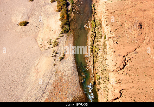 Aerial view of desert landscapes and river in the Sahara desert in Morocco. - Stock Image