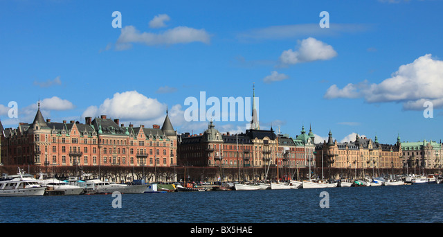 View from the see over Strandvägen Stockholm, Sweden with old houses and anchored boats. - Stock Image