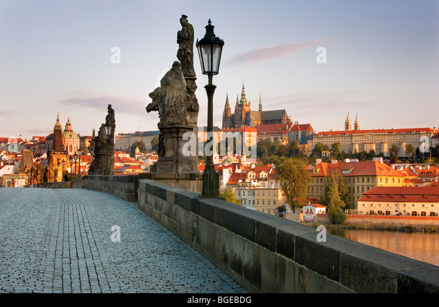 View of Charles' Bridge by Vltava River with Prague Castle in the distance. Shot in Prague, Czech Republic. - Stock Image