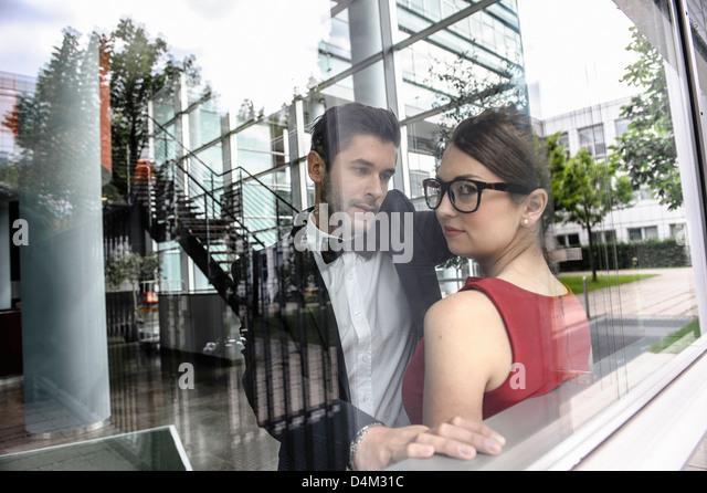 Couple standing by window - Stock-Bilder