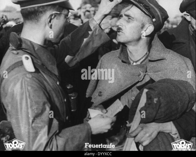 A German officer with a Polish prisoner - Stock Image