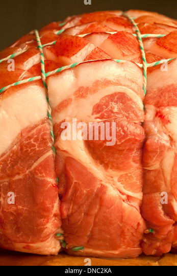 Close up / detail raw tied pork roast - Stock Image