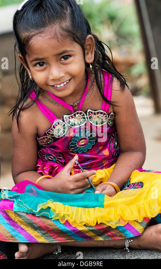 Colourful smiling Indian girl in a rural indian village. Andhra Pradesh, India - Stock Image