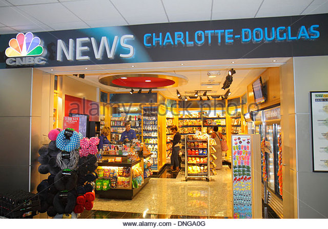 Charlotte North Carolina Charlotte Douglas International Airport CLT terminal concourse gate area CNBC News convenience - Stock Image