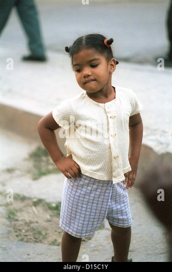Santiago de Cuba, Cuba, the little girl with the hands in the hips - Stock Image