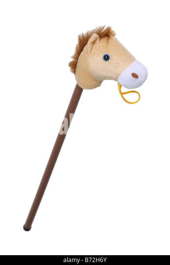 Stick horse toy cut out on white background - Stock Image