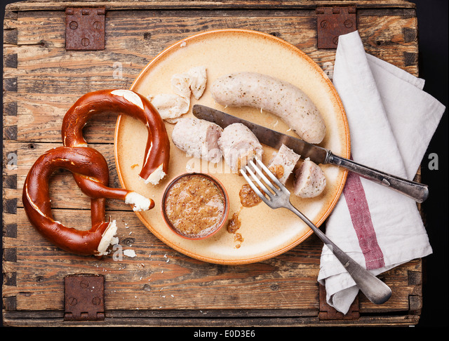 Bavarian snack with weisswurst white sausages and pretzel - Stock Image