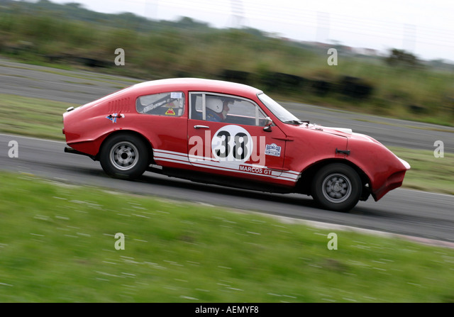 Des Quinn from Dublin in his red 1 3 Mini Marcos at Kirkistown Circuit county down Northern Ireland side view - Stock Image